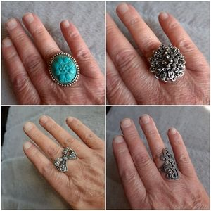 Jewelry - Set of 4 silver tone rings